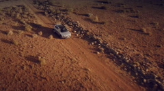 Close up front aerial view of a 4 by 4 car through the desert. Spain. Stock Footage
