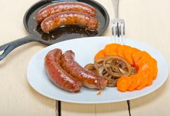 beef sausages cooked on iron skillet - stock photo