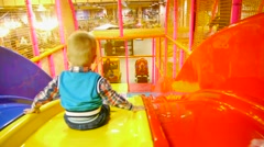 Child down with slides, children's city, attraction, boy, colorful slides, happy Stock Footage