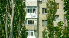 Woman on the balcony, someone spying on a woman, the house next door, Stock Footage