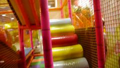 Child running around attraction, children's city, attraction, boy, colorful slid Stock Footage