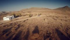 Wide lateral aerial view of a 4 by 4 car through the desert. Spain. Stock Footage