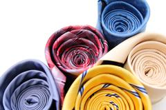 bright rolled ties isolated on a white - stock photo