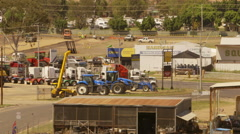 Moree plains town trucks arriving from outback highway Stock Footage