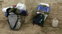 Nepal Porter baskets carrying various bags and items sitting outsite Solukhumbu, Stock Footage