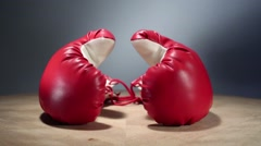 Boxing gloves rotate on table Stock Footage