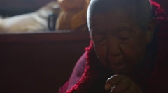 Nepal Himalayas  Buddhist nun at the Kharigandentenphelling Monastery in the Stock Footage