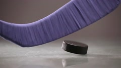 Hitting hockey puck Stock Footage