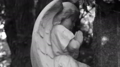 Angel statue in a cemetery/ Black and white footage Stock Footage