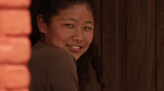 Kathmandu Nepal girl in childrens home sitting in doorway in Eastern Kathmandu, Stock Footage