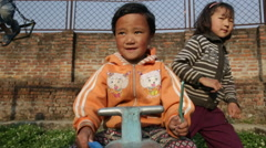 Kathmandu Nepal child poses for camera and plays in playground at childrens home Stock Footage