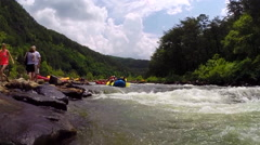 Tourists Whitewater rafting on the Ocoee River in Ducktown, Tennessee USA Stock Footage