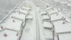 AERIAL: Heavy snowing in suburbia - stock footage