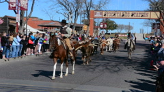 Ft Worth Texas with the famous The Stockyard on Main Street with cowboys heading Stock Footage