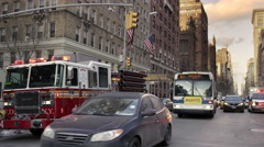 Firetruck parked ambulance cars 5th Ave traffic Empire State Building NYC Stock Footage