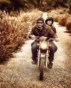 Riding on motorbike - stock photo