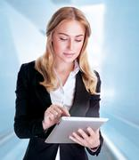 Business woman using touch pad Stock Photos