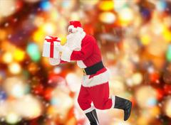 Man in costume of santa claus with gift box Kuvituskuvat