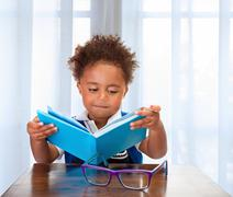 Little schoolboy read book Stock Photos