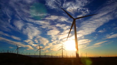 Footage - Wind Turbines at Dawn with Beautiful Cloudscape Stock Footage
