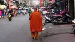 Buddhist Monk Walking in Meditation on Busy Street in Ho Chi Minh City, Vietnam Stock Footage