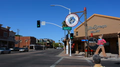 Old Scottsdale Arizona sign for tourist area and woman walking on 5th Avenue and Stock Footage