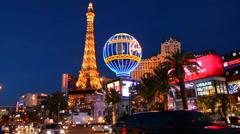 Las Vegas Nevada gambling on The Strip with Paris Casino at night exposure and Stock Footage