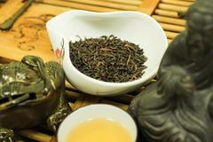 Quality dried Chinese tea leaves with freshly brewed drink. Stock Photos