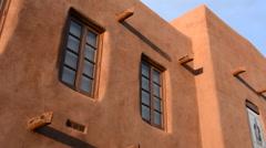 Santa Fe New Mexico artwork on stucco buildings - stock footage