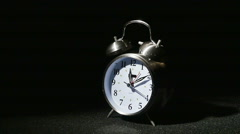 3172 Ringing Alarm Clock Being Hit by a Baseball in Slow Motion - stock footage