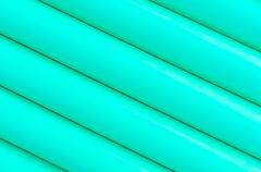 green plastic tubing pattern texture background - stock photo