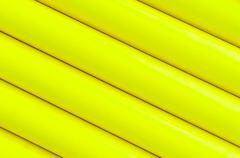 Yellow plastic tubing pattern texture background - stock photo