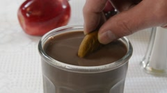 Dipping a cookie in coffee Stock Footage