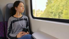 Traveling on train, listening to music Stock Footage