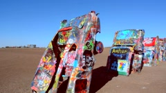 Amarillo Texas famous Cadillac Ranch off of Route 66 graphic look at old - stock footage