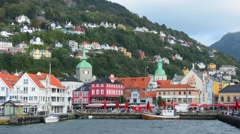 Bergen Norway Bryggen old town old and harbor with pier buildings and area for Stock Footage