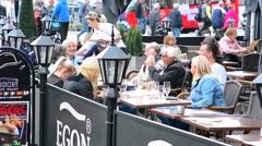 Bergen Norway Econ Restaurant  outdoor cafe relaxing tourists in  BRYGGEN Stock Footage