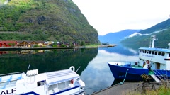 Flam Norway small beautiful village on lake with ferries and boats deep in Stock Footage
