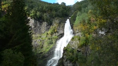 Stalheim Norway waterfall called Sivlefossen from mountain in green setting Stock Footage