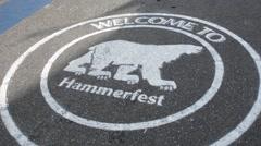 Hammerfest Norway cruise Hurtigruten polar bear sign on walk  northern most town Stock Footage