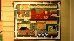 Stock Video Footage of Harstad Norway cruise Hurtigruten artwork quilt in oldest house in Northern