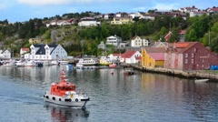 Kristiansund Norway cruise Hurtigruten colorful village from water of fishing Stock Footage