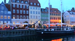 Copenhagen Denmark famous Nyhavn night exposure of color homes and boats with Stock Footage