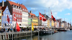Copenhagen Denmark famous Nyhavn color homes and boats with crowds Kobenhavn Stock Footage
