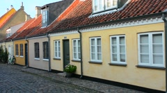 Odense Denmark beautiful old row homes cobblestone streets in Hans Christian Stock Footage