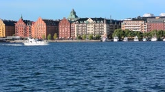 Stockholm Sweden downtown beautiful buildings on Riddarfjarden water Stock Footage