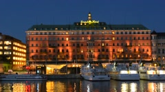 Stockholm Sweden skyline and Grand Hotel at twilight on water night exposure Stock Footage
