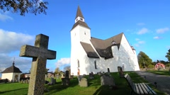 Sorunda Sweden beautiful white church and cemetery in small picturesque town - stock footage