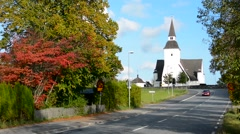 Sorunda Sweden beautiful white church and cemetery in small picturesque town Stock Footage