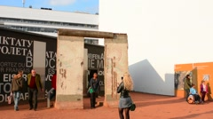 Berlin Germany Checkpoint Charlie museum Berlin Wall pieces tourists fear - stock footage